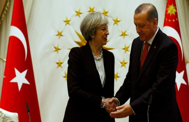 Turkish President Recep Tayyip Erdogan shakes hands with British Prime Minister Theresa May after their meeting at the presidential palace in Ankara, Turkey, Jan. 28, 2017.
