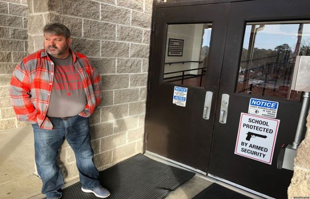Many Arkansan schools have begun arming faculty in hopes of preventing a future school shooting. Coach Dale Cresswell stands outside a Heber Springs, Ark., school, Dec. 11, 2018