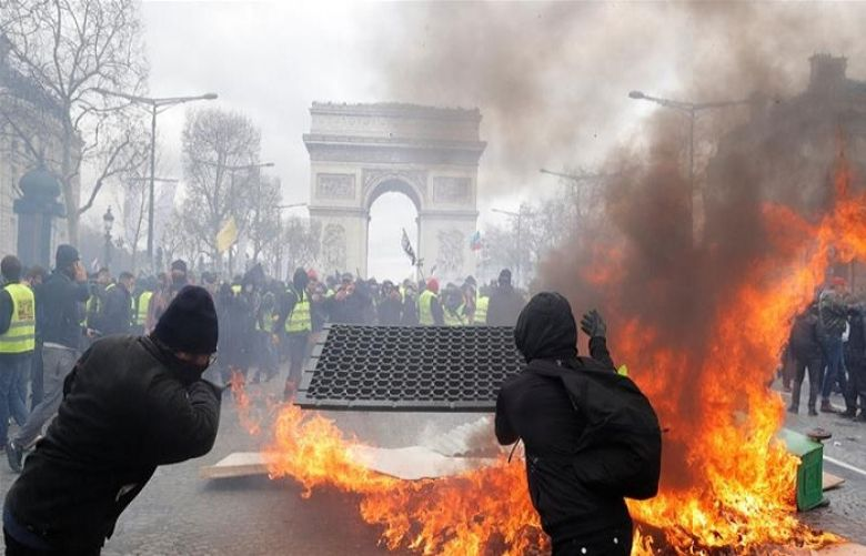 Police used tear gas and water cannons to repel protesters who gathered at the foot of the Arc de Triomphe