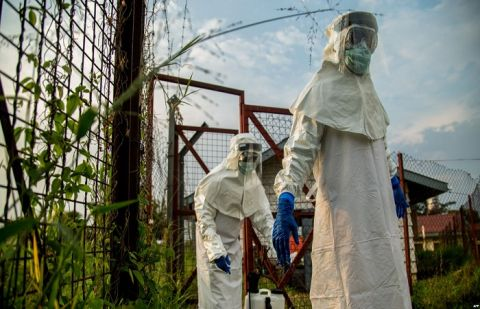 Medical staff are sterilized before entering the isolation unit at a hospital in Bundibugyo, western Uganda, on Aug. 17, 2018, where there is one suspected case of Ebola.