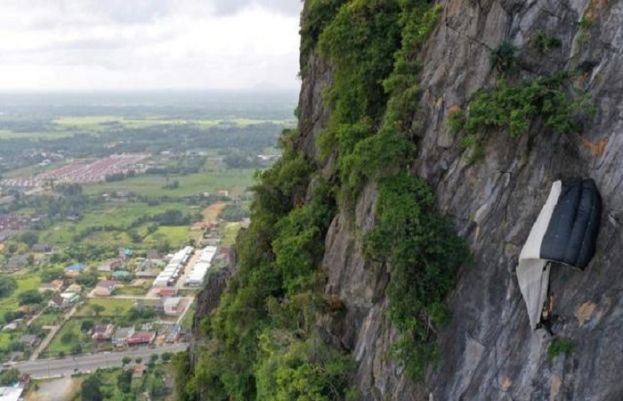 Hanging around: BASE jumper saved from Thai cliff after parachute snags