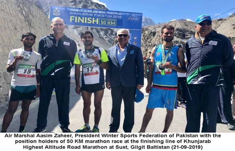 Air Marshal Aslm Zaheer, President Winter sports federation of pakistan with the position holder of 50 km marathon race at the finishing line of khunjarab