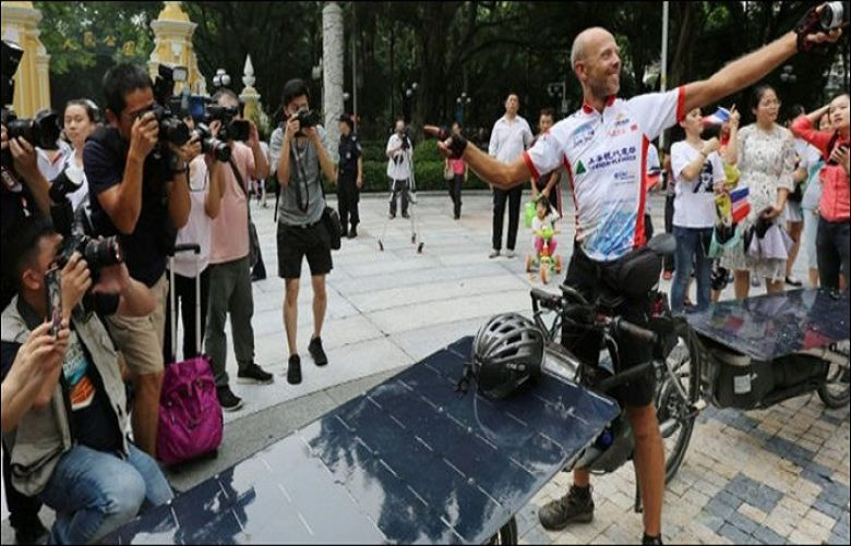 Biker wins first France to China 'Solar bike' race
