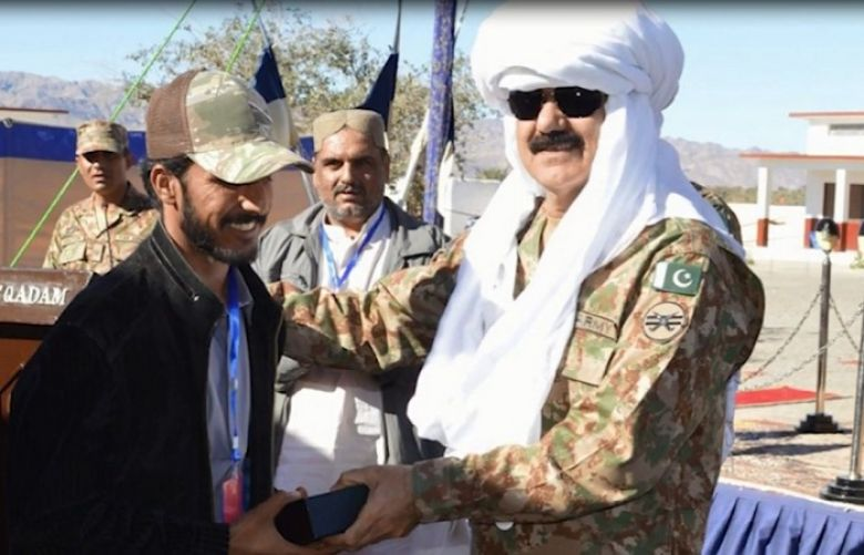 Pak Army hands over homes, shops of model village to displaced people in Mashkai