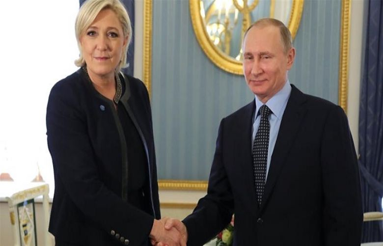 Russian President Vladimir Putin shakes hands with former French presidential election candidate Marine Le Pen during their meeting in Moscow on March 24, 2017