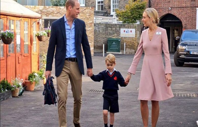 Prince William and Head of Lower School, Helen Haslem, escort Prince George