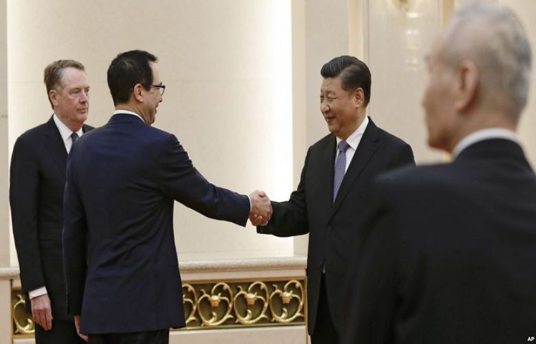 U.S. Treasury Secretary Steven Mnuchin, second from left, shakes hands with Chinese President Xi Jinping as U.S. Trade Representative Robert Lighthizer, left, and Chinese Vice Premier Liu He, right, look on before their meeting at the Great Hall of the Pe