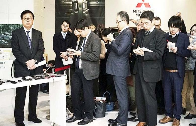Mitsubishi Motors CEO Osamu Masuko listens to reporters' questions during a press conference at its headquarters in Tokyo on Friday.