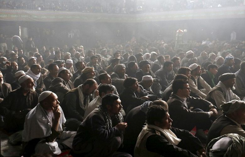 Hundreds gather to attend a procession in Kabul, Afghanistan to mark Ashura