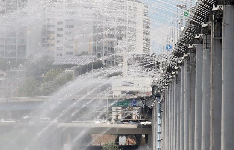 Water is sprayed amid sweltering heat at the Banpo Bridge over the Han River in Seoul