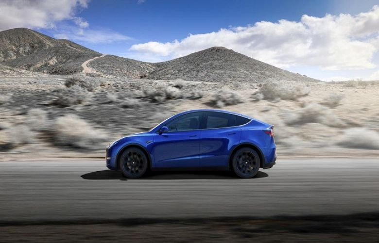 Tesla unveils Model Y as electric vehicle race heats up