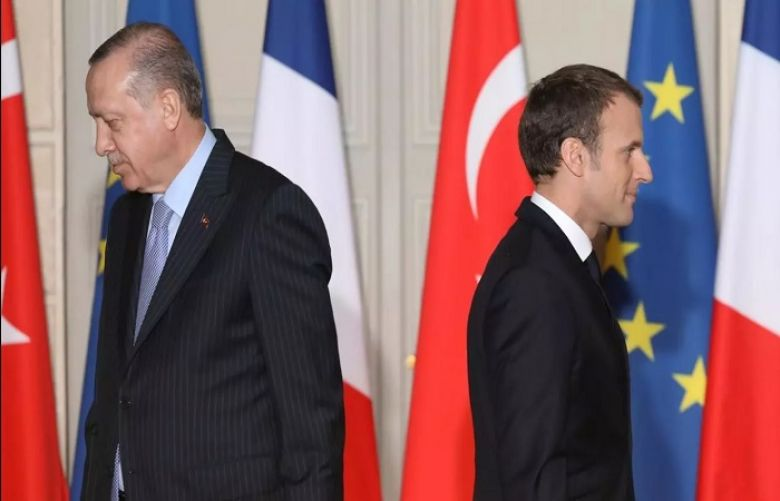 Tayyib Erdogan and  Emmanuel Macron