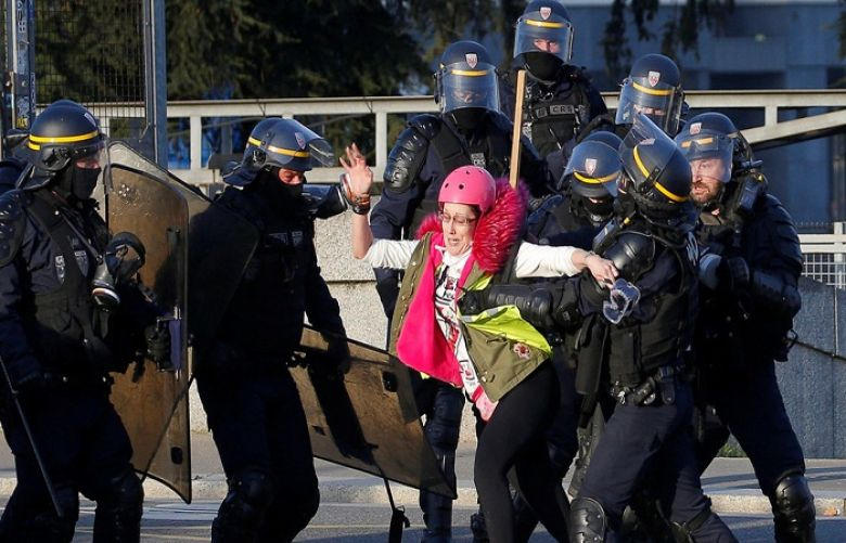 "A protester is pushed back by police during a demonstration of the ""yellow vests"" movement in Nantes, France, February 16, 2019."