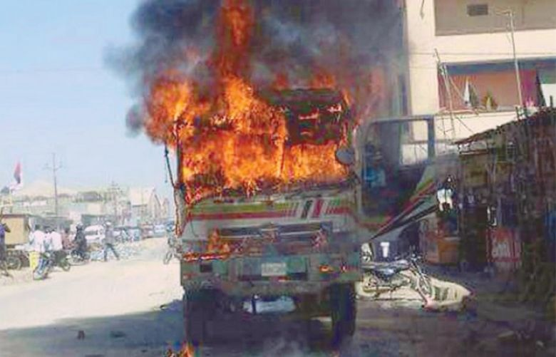 A dumper truck set on fire in Karachi