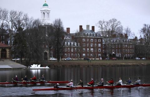 Rowers pass the campus of Harvard University as they move down the Charles River in Cambridge, Mass., March 7, 2017.