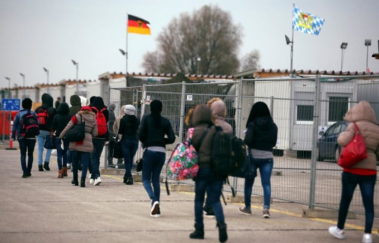 Eritrean migrants walk after arriving by plane from Italy at the first registration camp in Erding near Munich, Germany on Nov. 15. Government data showed that roughly 280,000 people entered Germany last year in search of asylum, down from a record of about 890,000 in 2015.