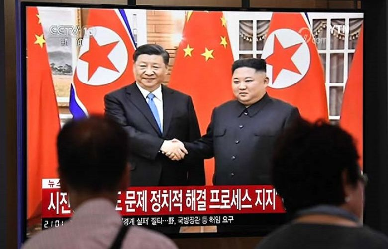 North Korean leader Kim Jong Un welcomed Chinese President Xi Jinping to Pyongyang on Thursday