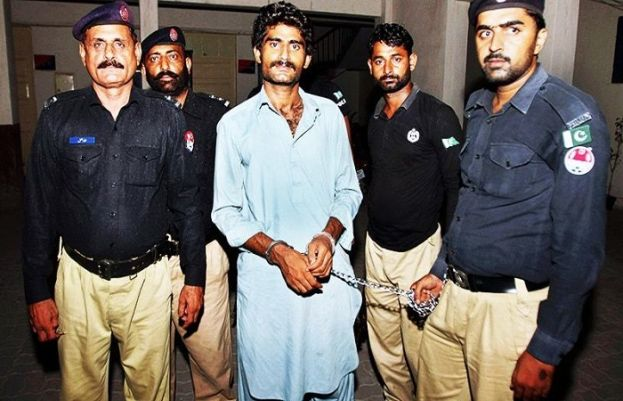 In this file photo, police officers present Waseem Azeem, the brother of slain social media star Qandeel Baloch.