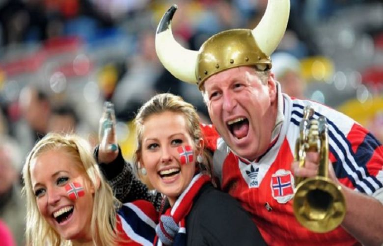 Happy Norwegian fans at an international football game in 2009