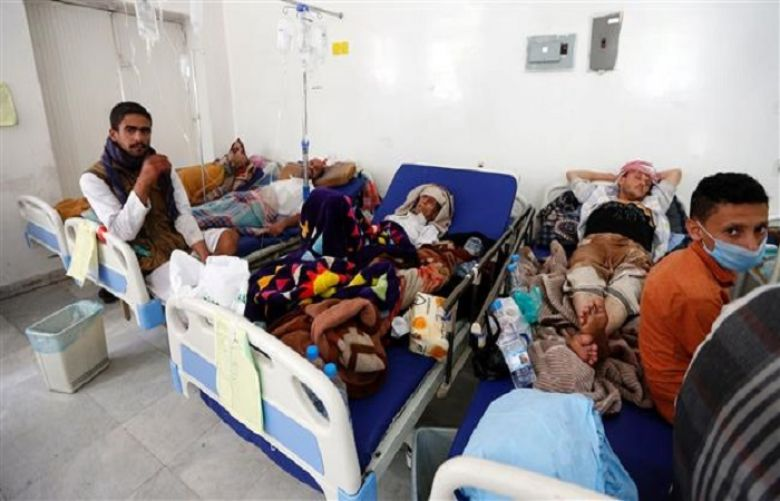 Yemeni men suspected of being infected with cholera receive treatment at a hospital in Sana'a on May 12, 2017.