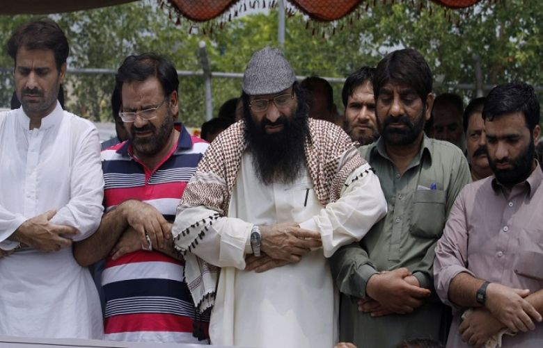 "In June, the US also designated as ""terrorist"" the group's top leader Syed Salahuddin (centre)"