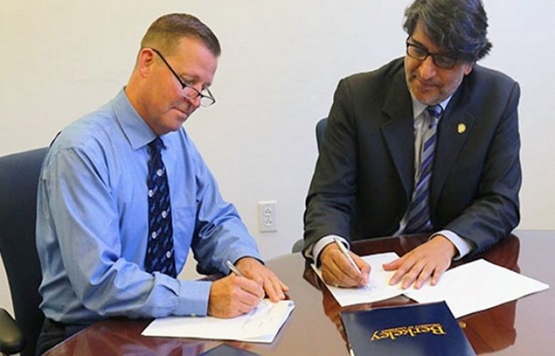 Officials of UC Berkeley and Habib University signing the MoU.