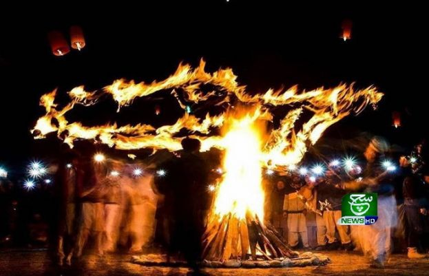 People dance around bonfire to celebrate Mayfung ferstival in skardu