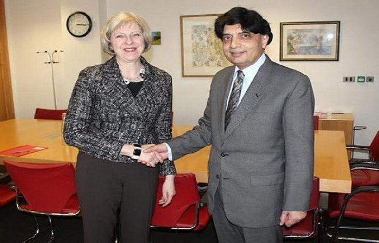 Britain's Prime Minister Theresa and Interior Chaudhry Nisar Ali Khan