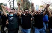 At least 6 killed, dozens wounded in gunfire near Beirut protest