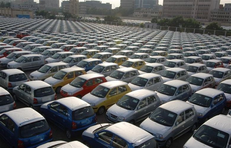 Cars are seen ready for shipment at a port