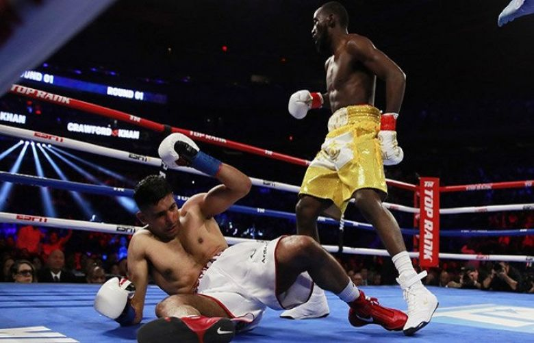 Terence Crawford beats Amir Khan to retain WBO welterweight title