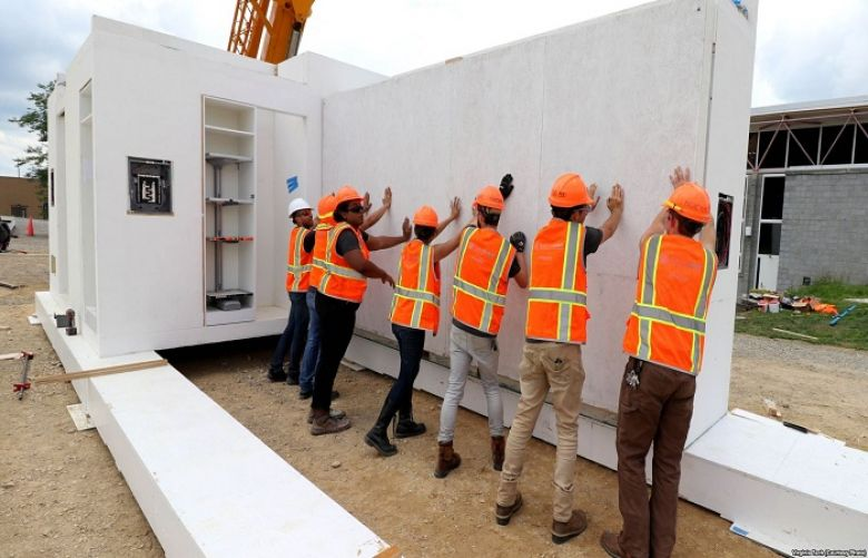 Virginia Tech students erect a futuristic solar home as they prepare to compete in the Solar Decathlon Middle East, an international collegiate competition to build the world's smartest solar home.