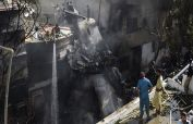 PIA investigation team inspects plane crash site