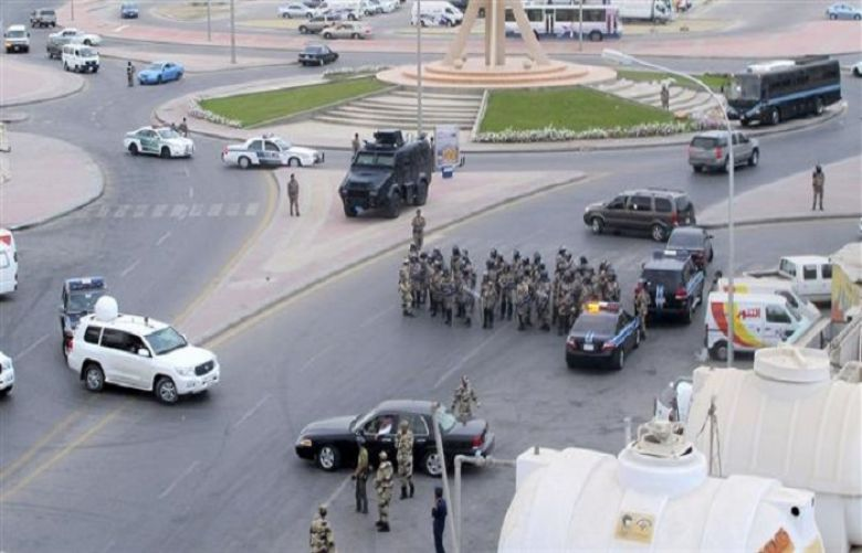 Saudi riot police gather as Saudi protesters (unseen) chant slogans during a demonstration in Qatif, Saudi Arabia, March 11, 2011.