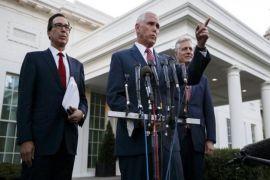 US slaps sanctions on Turkey over incursion, demands Syria ceasefire